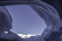 looking out of a glacier cave Canada