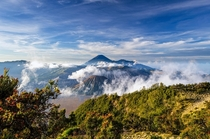 Looking out upon Mount Bromo and Mount Semeru  photo by Rivan Indra