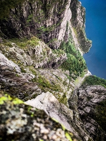 Looking over the edge of famous Preikestolen in Norway - straight down about ft  meters  - more info in the comments