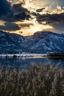 Looking over to Croatia from Bosnia Last sunrays hitting the snow covered Dinaric Alps Lipsko Lake near the town of Livno Bosnia and Herzegovina