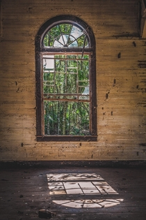 Looking through a window at an abandoned church in Florida OC