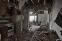 Looking Through the Kitchen into the Living Room of a Decayed Abandoned House
