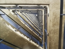 Looking up a stairwell on the Barbican Estate London  x
