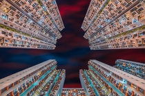 Looking up in an apartment complex in Hong Kong  by Peter Stewart