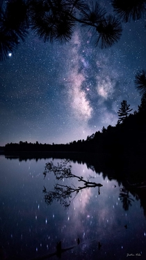 Looking up into our galaxy over the lake on a calm night near Drummond Wisconsin Photo by Justin Vrba