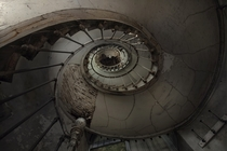 Looking up the staircase of a derelict manor house  Photographed by Andre Govia