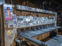 Lots of stickers on a machine in an abandoned manufacturing plant