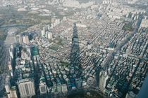 Lotte World Tower casts a giant shadow over Songpa District Seoul South Korea