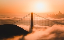 Low Fog at Golden Gate Bridge with the Bay Bridge amp San Francisco City Skyline in the back  OC  cbyeva