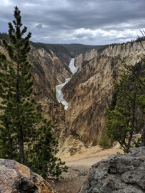 Lower Falls canyon in Yellowstone Park WY on a cloudy day looks unreal like soft pastel artwork