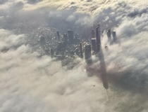 Lower Manhattan bathed in clouds