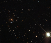 LRG-- and a gravitational lens of an even more distant galaxy LRG is the acronym given to a catalog of Luminous Red Galaxies found in the Sloan Digital Sky Survey SDSS These are mostly really massive elliptical galaxies full of huge numbers of old stars