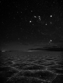 Luminous night sky consists of bright familiar stars of Orion the hunter amp aldebaraneyes of Taurus the bull over Salar de Uyuni planet Earths largest salt flat Credit Stephanie Ziyi Ye