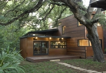 Lush Tree Canopy enshrouds Contemporary spin on Modern Cabin - Austin TX