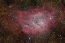 M The Lagoon Nebula -- Twisting near the center of the Lagoon the small bright hourglass shape is the turbulent result of extreme stellar winds and intense starlight