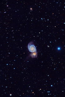 M The Whirlpool Galaxy gobbling up its galactic neighbor details in comments