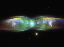 M- Wings of a Butterfly Nebula -- In the center two stars orbit inside a gaseous disk  times the orbit of Pluto The expelled envelope of the dying star breaks out from the disk creating the bipolar appearance