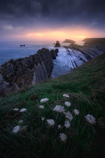 Magical sunrise above the rugged coastline of norther Spain Santander