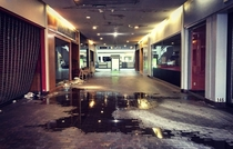 Main entrance to the abandoned Burlington Center Mall during a water main break You can even see the white fire alarm light flashing on the ceiling