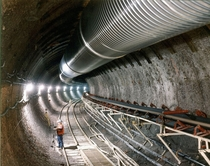 Main tunnel of the Yucca Mountain Nuclear Waste Repository  mi  km long and  ft  m wide