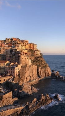 Manarola one of the five Cinque Terre cities in southern Italy basking in a sunset