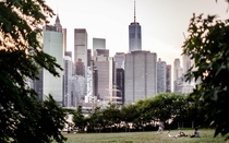 Manhattan skyline dwarfing a park in Brooklyn - New York NY -