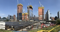 Manhattans West Side Yard where all the LIRR trains go to rest after traveling across Long Island dwarfed by the massive and fast-growing Hudson Yards development program in the background