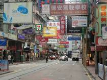 Mass amount of street signs on a central Hong Kong street