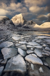 Massive chunks of ice  dramatic sunrise  perfect morning Lofoten Norway