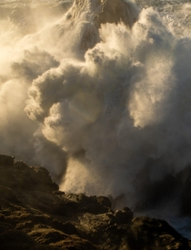 Massive ft waves crashing along the California Coast