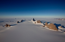 Massive spires of rock rise dramatically out of the ice Ulvetanna Peak Antarctica - Photo by Alastair Lee