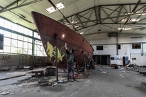 Me in front of an old ship in an abandoned shipyard