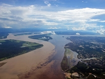 Meeting of waters - confluence between the Rio Negro almost black colored and the sandy-colored Amazon River or Rio Solimes