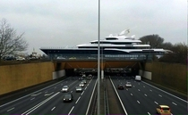 Mega-yacht crossing an aqueduct over a highway