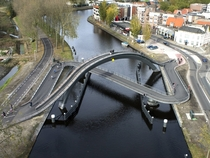 Melkwegbridge Purmerend Netherlands This bridge separates cyclists and pedestrians while still allowing easy passage for boats