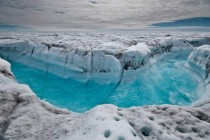 Melt water rushing along the surface of the Greenland Ice Sheet through a supra-glacial stream southwest of Ilulissat