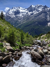 Meltwater rushing down in early summer in Valais Switzerland
