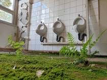 Mens Room in abandoned soviet army barracks close from Berlin Germany