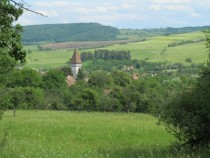 Mesendorf transylvania and a Saxon church from a meadow above the village