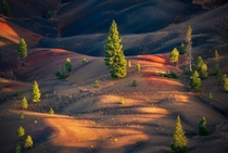 Mesmerizing Painted Dunes in Lassen Volcanic National Park California glowing during sunset