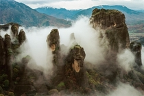 meteora greece on a foggy morning