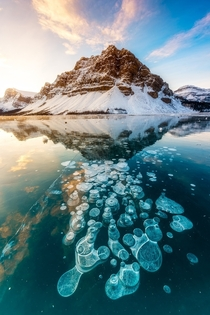 Methane gas bubbles trapped in Bow Lake Canada  by Mike Mezeul II