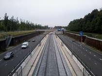 Metro tracks in the median of the Nieuwe Leeuwarderweg s for the future Noord-Zuidlijn  in Amsterdam the Netherlands