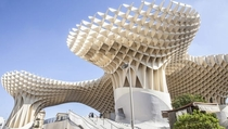 Metropol Parasol is a wooden structure at La Encarnacin square in Seville Spain Designed by German architect Jrgen Mayer April  The structure consists of six parasols in the form of giant mushrooms whose design is inspired by the vaults of the Cathedral o