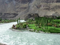 Mid-Day Sight of Chitral Valley Pakistan  by Afzal