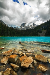 Middle Joffre Lake under a dark and looming sky BC Canada