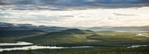 Midnight sun lighting the rolling hills and fells of Lapland on the border of Finland and Sweden