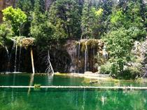 Mile high hike up to beautiful Hanging Lake Co Crystal clear water