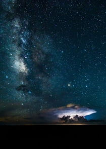 Milky Way over the Grand Canyon as lightning illuminates a cloud By Brendan Hall
