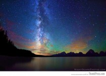 Milky Way stretches over the night sky above Jackson Lake